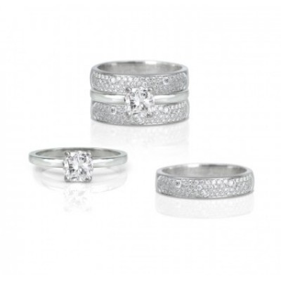 Solitaire engagement ring set with pave diamonds toronto