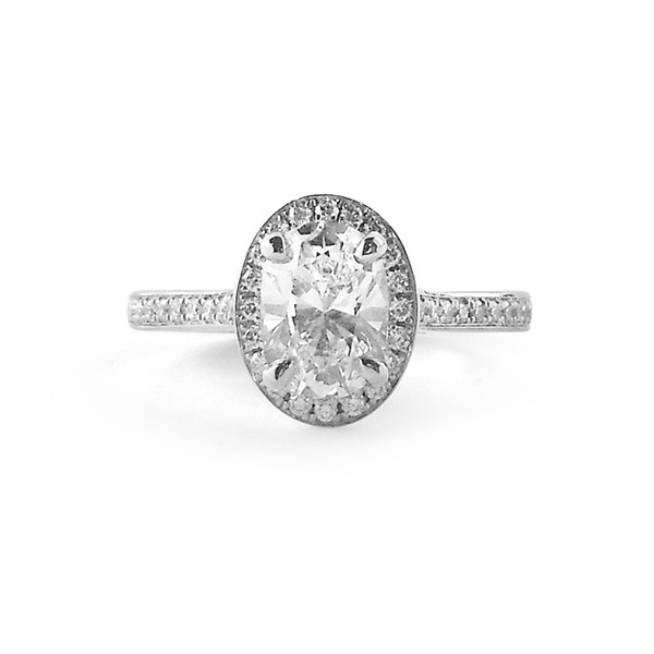 white gold or platinum halo engagement ring featuring oval