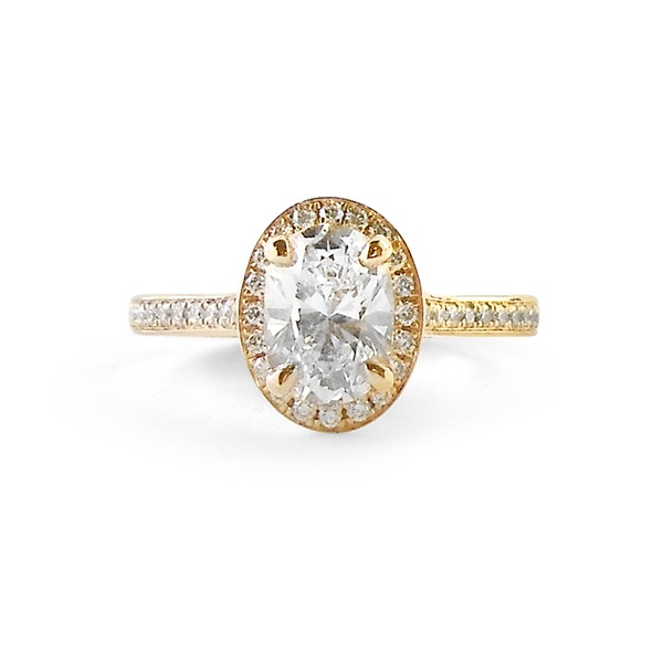 yellow gold halo engagement ring featuring oval
